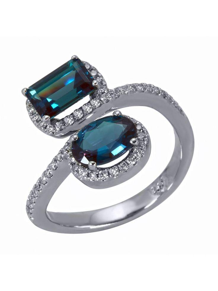 Mark Henry 18k White Gold Alexandrite Diamond Swirl Ring. 18k white gold swirl ring features two alexandrite stones in a pave diamond setting. Total alexandrite weight 2.04cts. Total diamond weight 0.31cts. $34,145.00