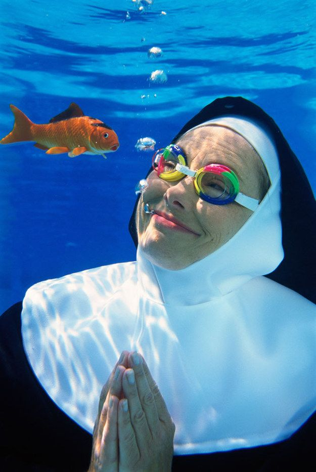 A nun discovering the joys of the ocean: | 50 Completely Unexplainable Stock Photos No One Will Ever Use