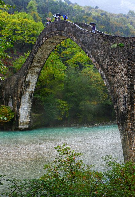 . Old bridge of Plaka over Arachthos river, a typical landscape of Epirus, Northwestern Greece. This bridge, built exclusively with stones in the 19th century, is considered to be the largest amongst the Balkan countries.