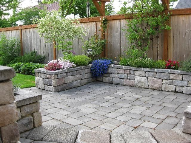 Stone patio with stone planter (or bench) around perimeter