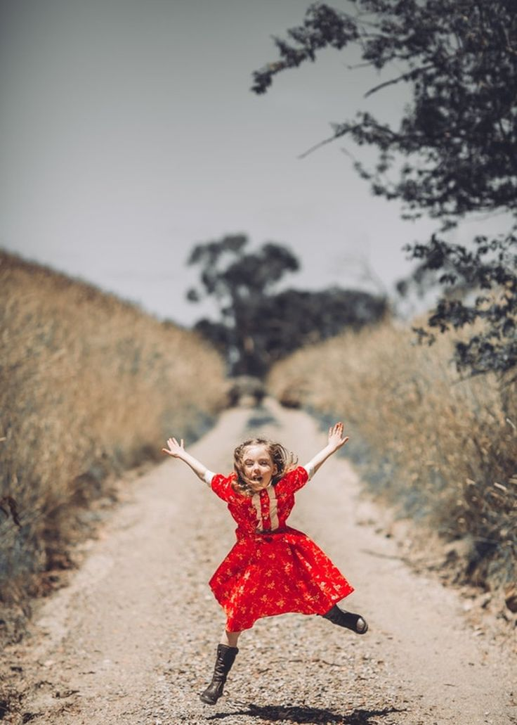 Jumping for joy. Vintage style for children. Natural moments photography. Children Photography. Natural Light. Melbourne Family Photography. Fine Art Photography