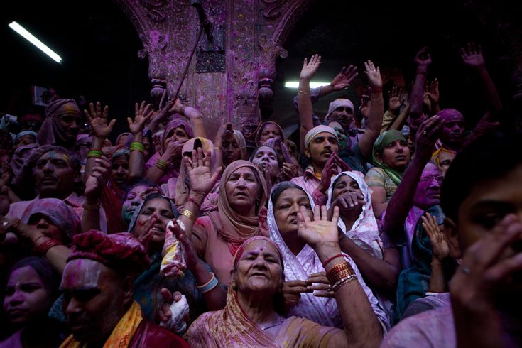 Hindu devotees pray at Banke Bihari Temple on March 21 in Vrindavan, India. (Majid Saeedi/Getty Images) #