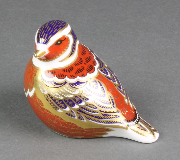 """Lot 46, A Royal Crown Derby paperweight in the form of a bird LV1 4"""", sold for £40"""