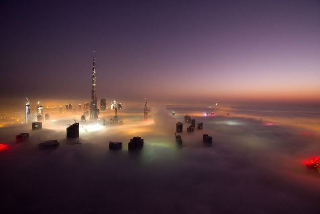 The city in the clouds: Dramatic images of Dubai's skyscrapers poking through a carpet of fog at night. WoooooW thats so awesome looking!