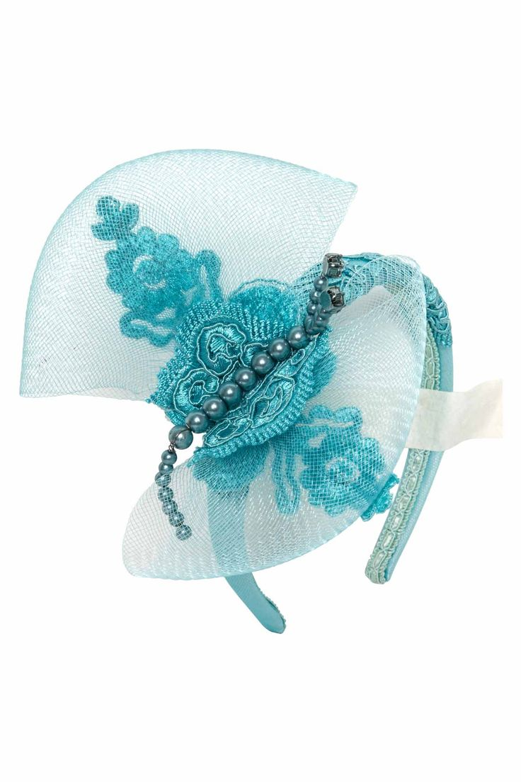 Beautifulturquoise headband with crine, precious embroidery and pearls hand-sewn.