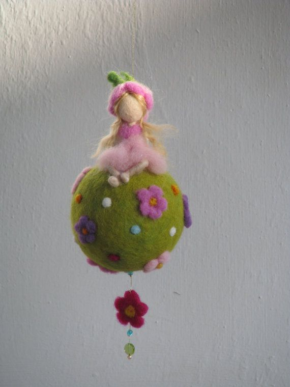 Waldorf inspired needle felted spring - fairy sitting on a ball.