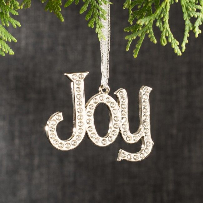 Trim your tree and make your holidays sparkle with ribbon held, crystal embellished ornaments! Available in Noel, Joy, Love, Hope, Peace and Wish.