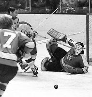 Pittsburg Penguins goalie Al Smith blocks shot from Seal Gary Jarrett..(1971 photo/Ron Riesterer)