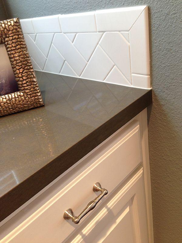 herringbone backsplash, painted white cabinets, grey walls, and Silestone  countertops… Via A Well Dressed Home by Emily Hewett