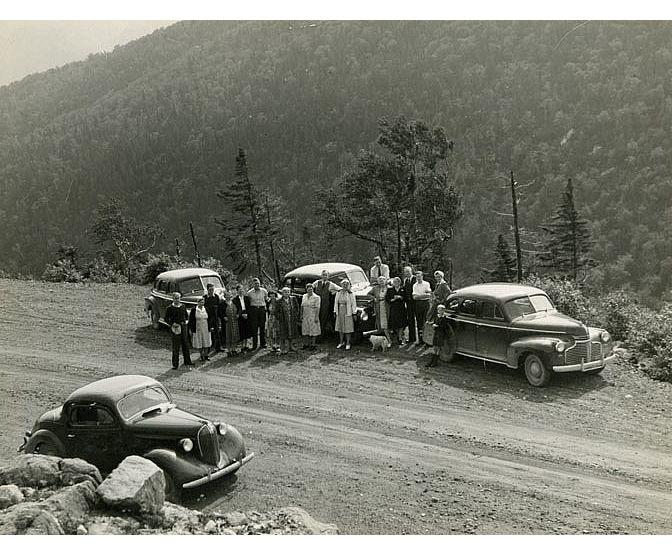 Group of People Posing Next to Their Cars on the Cabot Trail, ca. 1937.