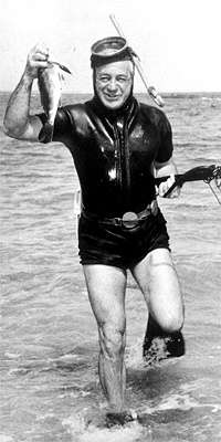 Harold Holt exiting the water at Portsea, Australian Prime Minister who would disappear at sea and never be found.