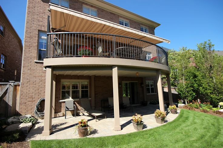 This curved upper deck is in Ancaster Ontario and was built by Hickory Dickory Decks using Clubhouse decking. The curved rail is out of aluminum. The awning is a great feature for shade.