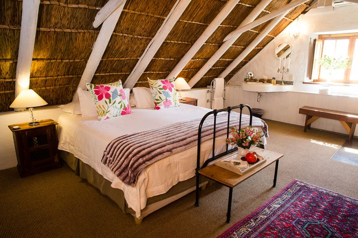 Classic Quarters - Room 4 is on the second floor off the upstairs communal lounge with a mountain facing view and a thatch roof and air-conditioning, king size bed, coffee & tea facilities, percale linen and beautiful Victorian bath with hand shower in main bedroom and en-suite toilet.