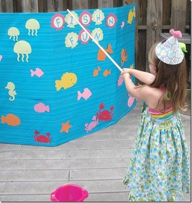 It was so easy to make out cardboard and wrapping paper. Get Sea Creatures from Etsy and for items to fish for....hmm