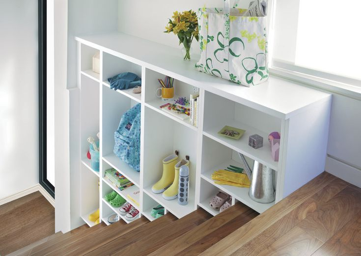 Stairway shelves. Remember those little wicker baskets designed to sit on your stairs? This is like those but on steroids. You can have a piece designed specifically for your stairs (as long as your stairs are wide enough to give up a little space) and use it for anything from shoes and bags to books and photo boxes.