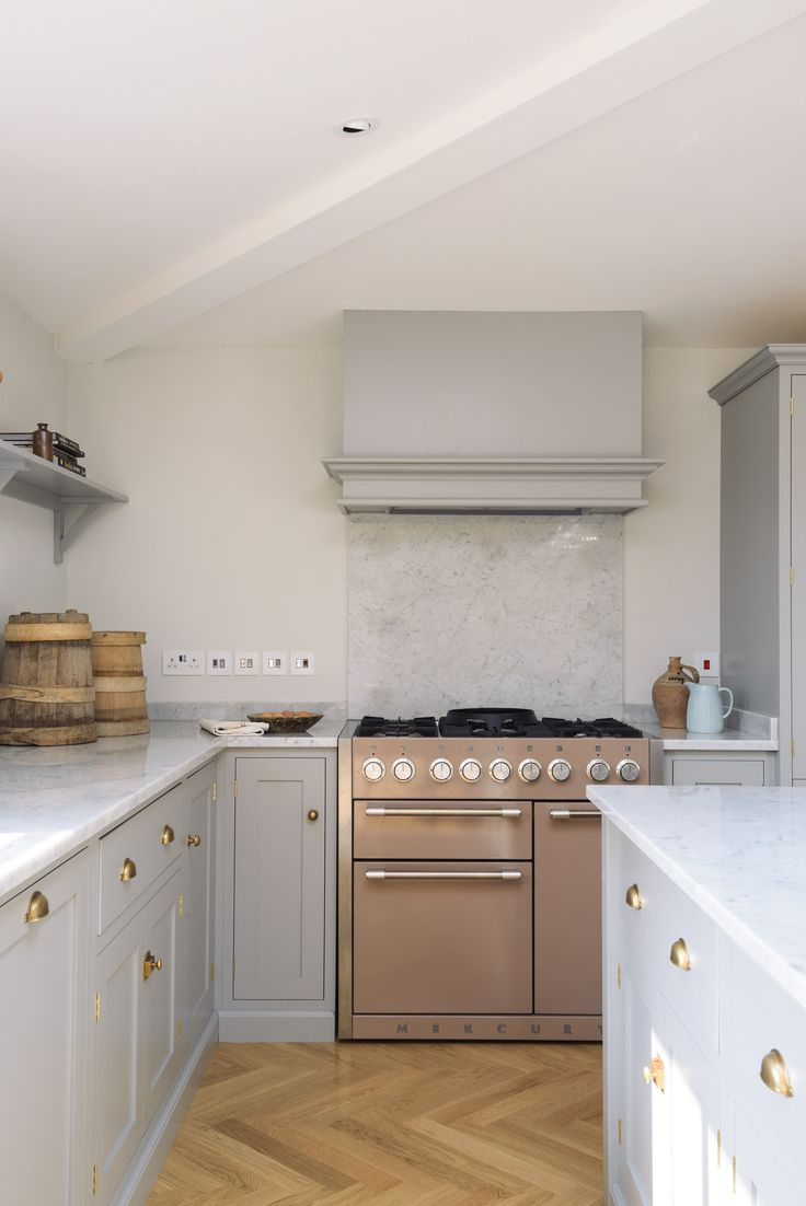 A Mercury range cooker in 'Truffle', parquet flooring and soft grey cupboards