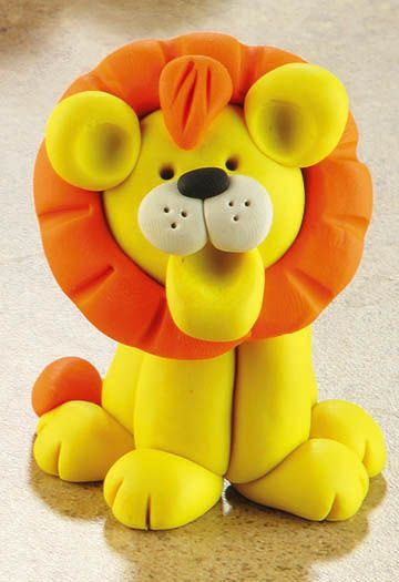 Fimo Lion. If you can do this with play clay, you could do it with fondant. It would make a lovely topper for a child's birthday cake.