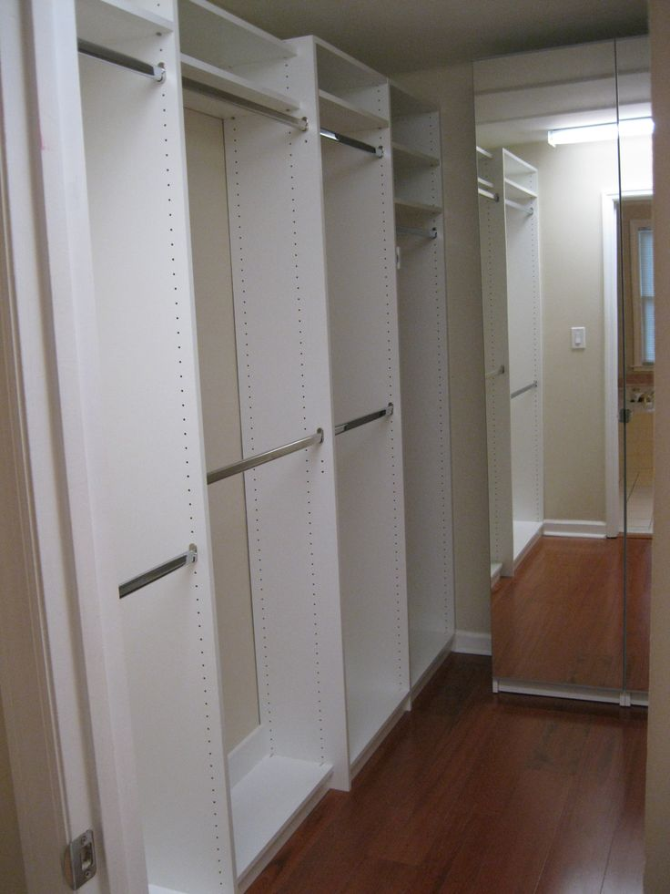 WHITE MELAMINE, FLOOR BASED SYSTEM HANGING WITH SHELVING BEHIND MIRRORED  DOORS. Www.closetsstorageandmore