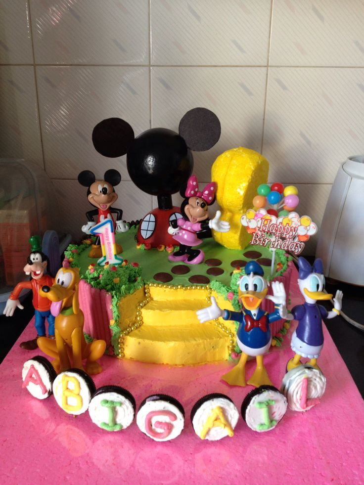 Mickey Mouse clubhouse birthday cake with buttercream and pocky fence. Self made for #abigailgunawan #firstbirthday