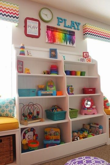 Great organizational space, and built in shelving idea for a kids play room! This can also be transitioned when the child gets older too!