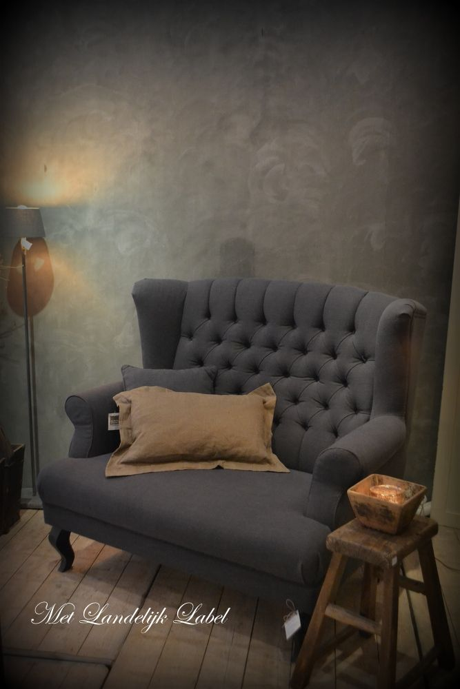 We are inspired by the smoky painted wall and tufted antique furniture of this traditional room.