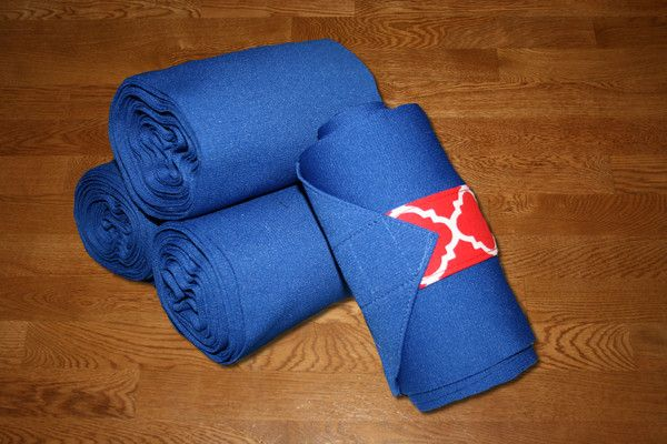 "Equine Standing Wraps/Royal Blue Standing Wraps w/Red Quatrefoil Velcro by KLMequestrian.com These stylish standing wraps are made of royal stretch polyester. The material is comparable to the stable bandages from Dover Saddlery. Made with industrial strength velcro to ensure a strong hold. Sold in Set of 4. Wraps Two sizes offered: Pony: 2 yards (6ft) long, 5"" wide or Horse: 4 Yards (12 ft) long, 5"" wide."