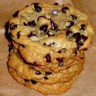 Paradise Bakery Chocolate Chip Cookie Recipe: 1 cup butter, 1 cup sugar, 1/2 cup brown sugar, 2 eggs, 2 teaspoons vanilla, 2 1/4 cups flour, 1 teaspoon baking soda, 1/2 teaspoon salt, 1 12 ounce bag semi-sweet chocolate chips. Preheat oven to 375, cream together butter and sugar, beat in eggs and vanilla. In a separate bowl, combine flour, salt, and baking soda. Gradually beat into butter/sugar mi