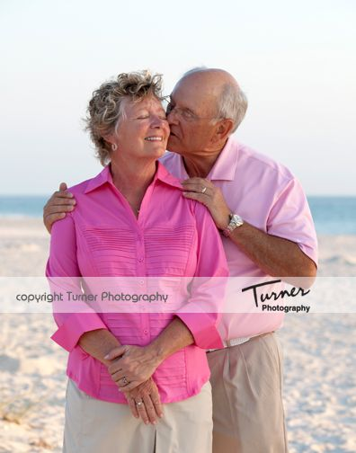 beach portraits older couple. Love the sweet ness of hands placed on the shoulders.