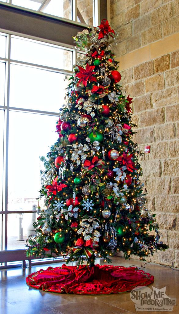 Red Platinum Christmas Tree Theme decorates a #Business. Show Me Decorating's Corporate Christmas #christmastrees #christmasdecor #christmasideas #redgreenandsilver