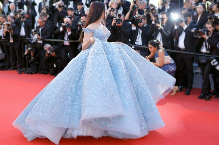 Aishwarya Rai Bachchan as she flaunts her Cinderella look in a powder blue ballroom off shoulder gown with plunging neckline at 2017 Cannes Film Festival red carpet.