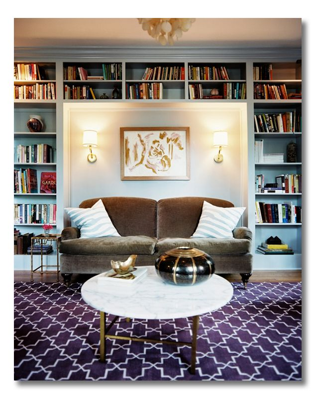 Love: the velvet sofa in the nook, the painted bookshelves, the sconces and, no, I would not get tired of that rug in a week or two.