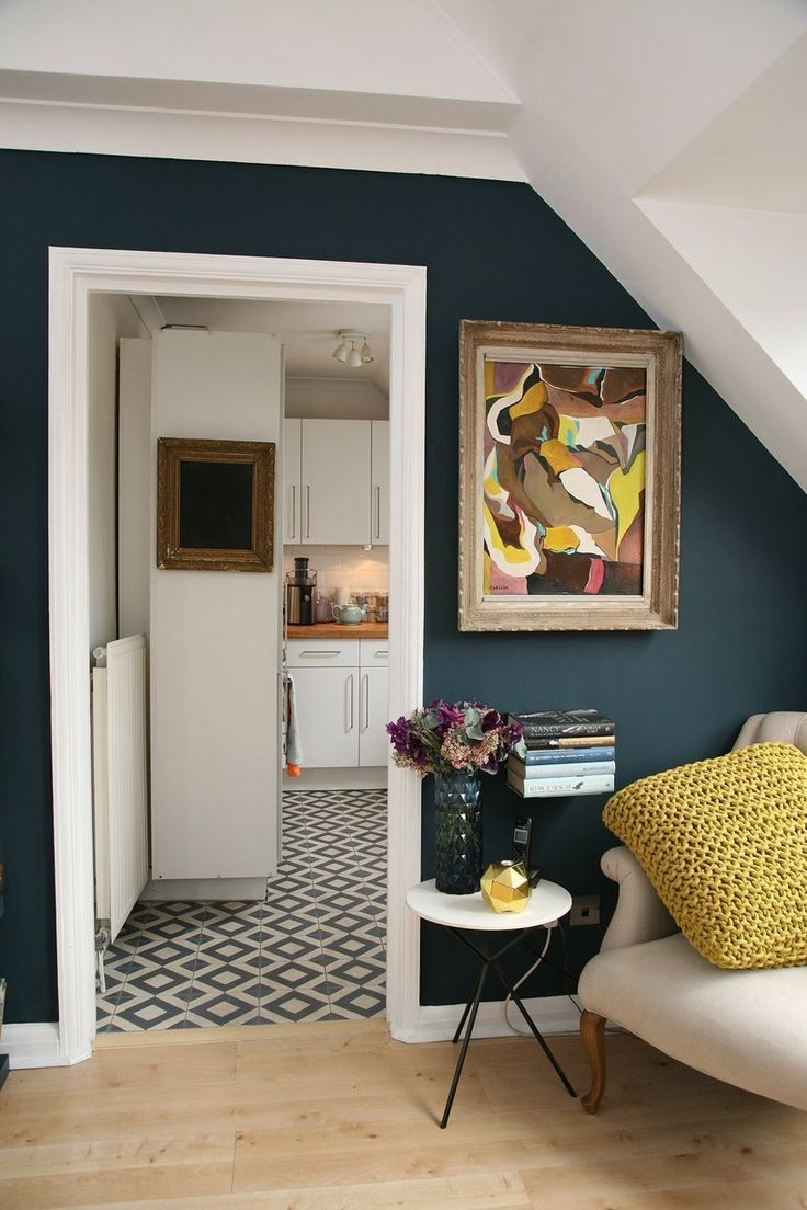 Cozy dark blue living room + walk into vintage inspired kitchen. When do I move in?!