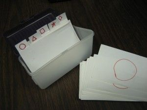 It's a space efficient way to store a variety of types of tasks that is functional. If your student goes on to work in an office setting – they have index card holders there!  sort by colors, shapes, numbers, letters  begin with small field of two or three and add as appropriate