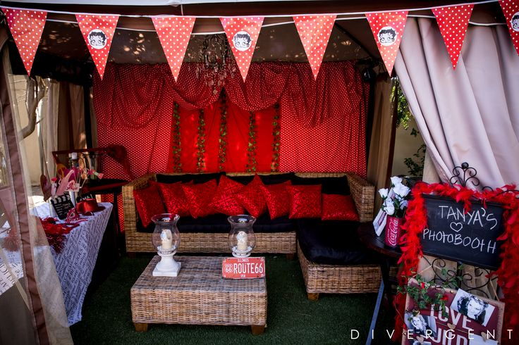 Red, Black and White themed garden birthday party fun photo booth