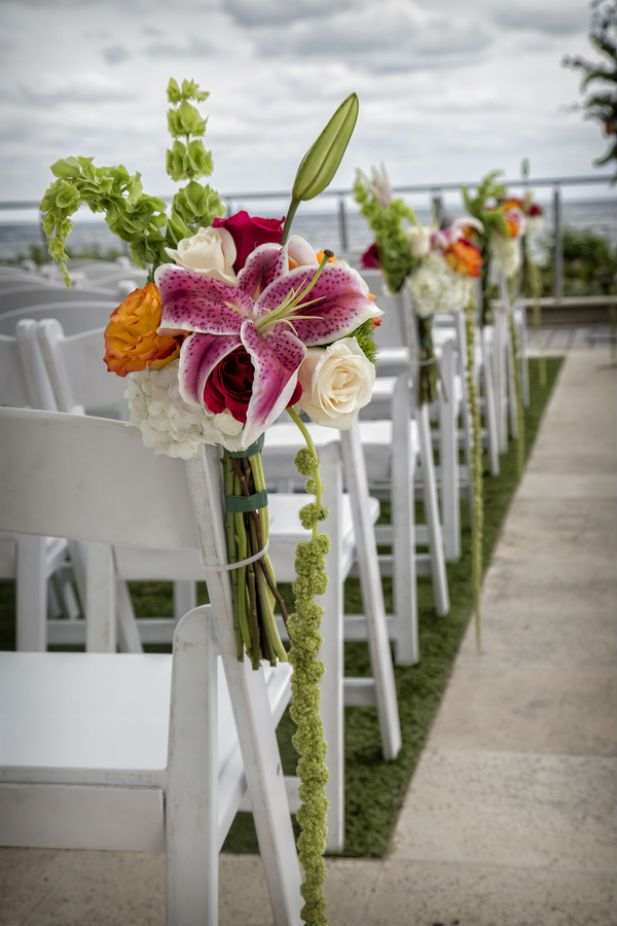 Tropical floral aisle markers (Photo by Jeff Kolodny Photography)