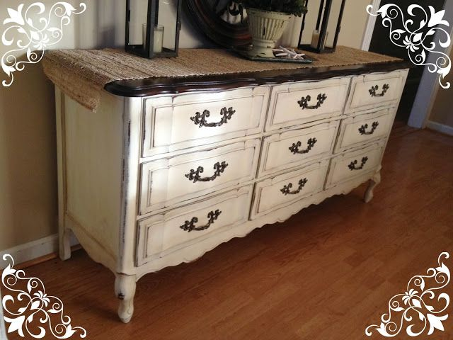 I applied 2 coats of Annie Sloan Old White Chalk Paint. Sanded edges to distress a bit. Gave it a clear coat of Annie Sloan Clear Wax. Then heavily distressed with Annie Sloan Dark Wax. I repainted all of the hardwar