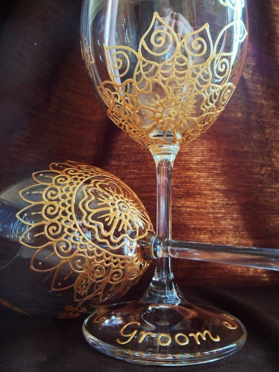 Bridal party gift -one of a kind wine glasses. Personalized (option) designed with symbolism in Henna style designs. Gold, copper or Pewter. Mehndi Glass via Etsy.