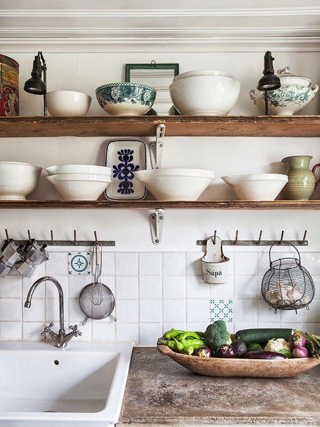 open shelves, bowls, lighting, hooks, garlic basket, dough bowl