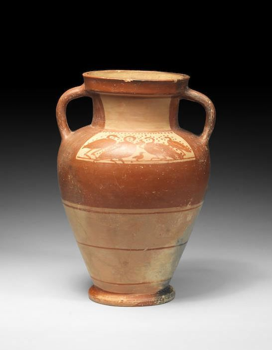 Etruscan pottery amphora, 4th century B.C. The upper section decorated with black slip, two panels decorated respectively with five swans and four swans with two cygnets, with dots on the field, the lower half left blank with three parallel black lines, 32 cm high. Private collection