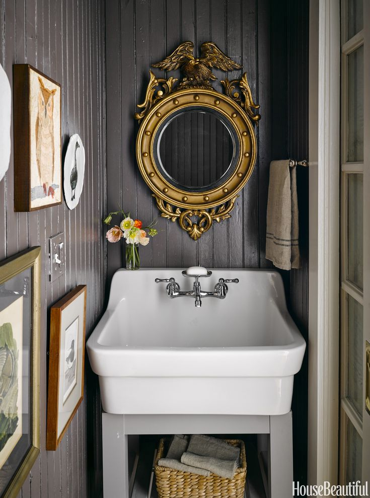 In the powder room, a Federal mirror from the new Ken Fulk Collection for Pottery Barn hangs over American Standard's Country sink and Heritage faucet.