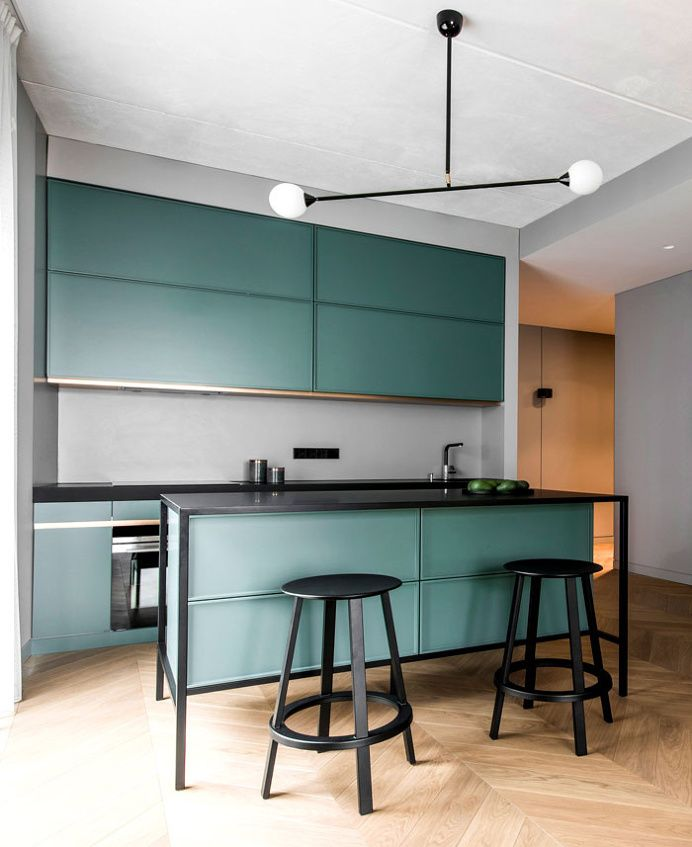 Apartment in Grey Tones by AKTA in Kitchens