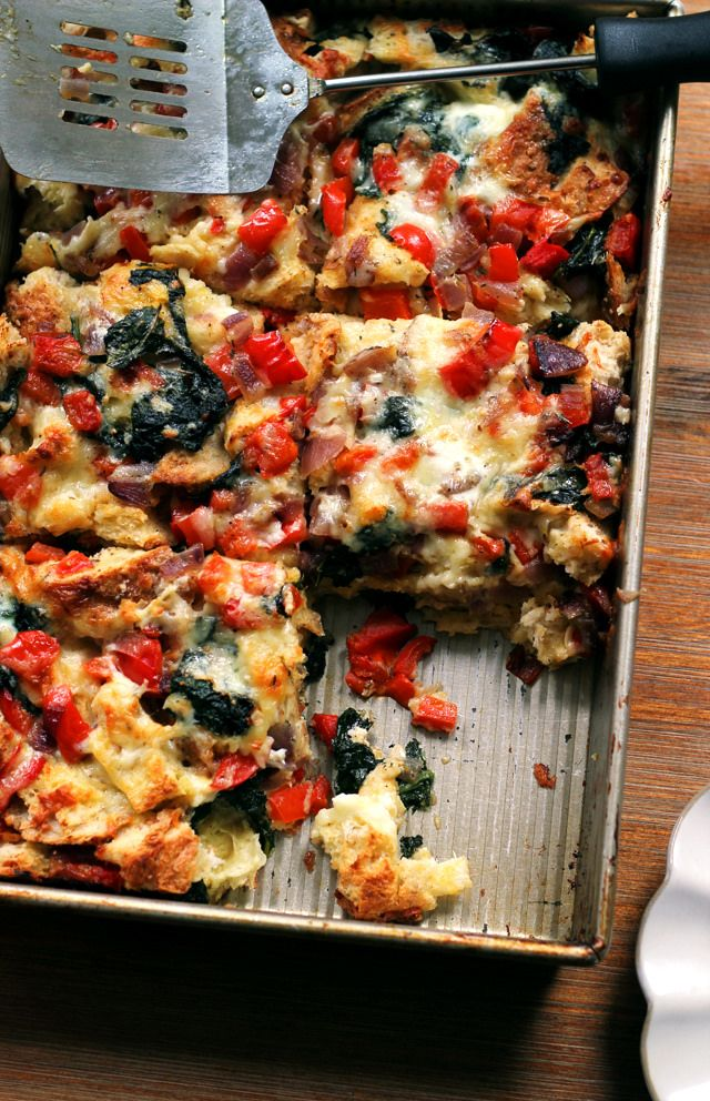 This vegetable and cheddar strata is a savory bread pudding made with eggs, cheese, and LOADS of veggies. It's the perfect make-ahead meal for a brunch or lazy weekend breakfast.