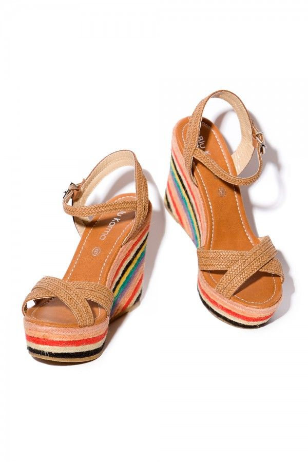 The summery wedges with their colourful striped raffia wedge heels  guarantee a fabulous summer feeling.