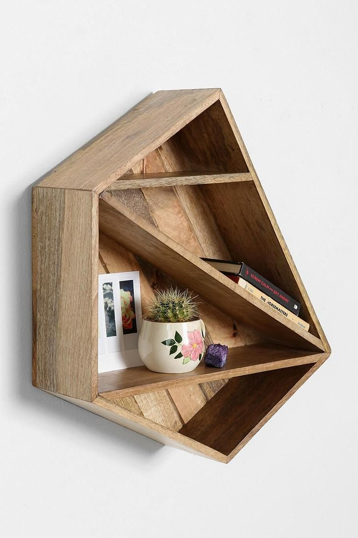 Wooden geometric shelf from Magical Thinking.---Too bad this isn't cheaper and in a darker wood