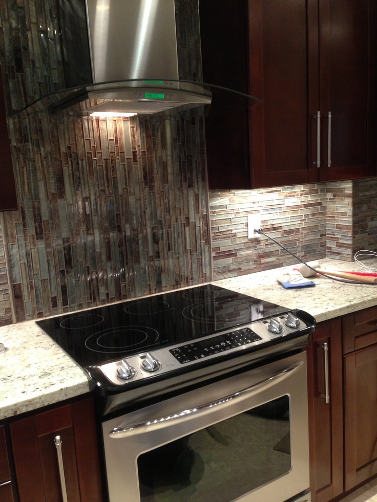 Glass Kitchen Hoods ~ Newly remodeled galley kitchen with glass backsplash and