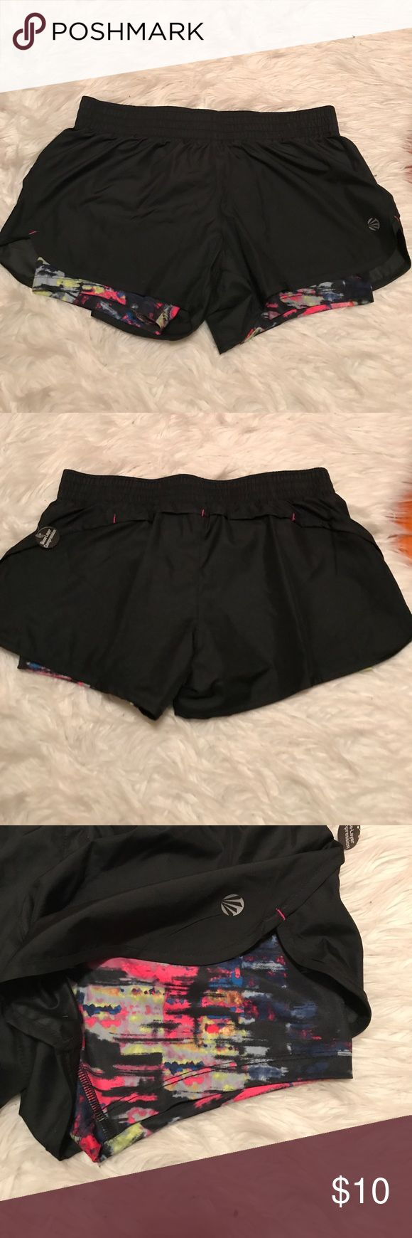 Athletic shorts Jillian Michaels athletic shorts. Built in spandex shorts underneath. Black with multi color spandex! Jillian Michaels Shorts