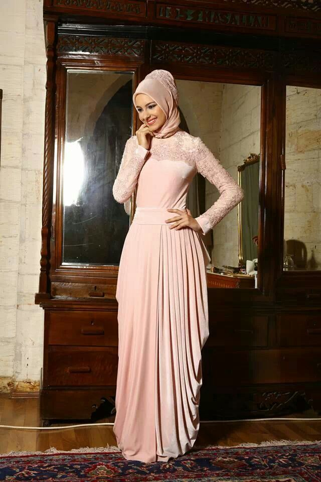 LOVE the asymmetric drape on the skirt. (may be exaggerated by the pose, but its a great idea anyway) Turkish style hijab