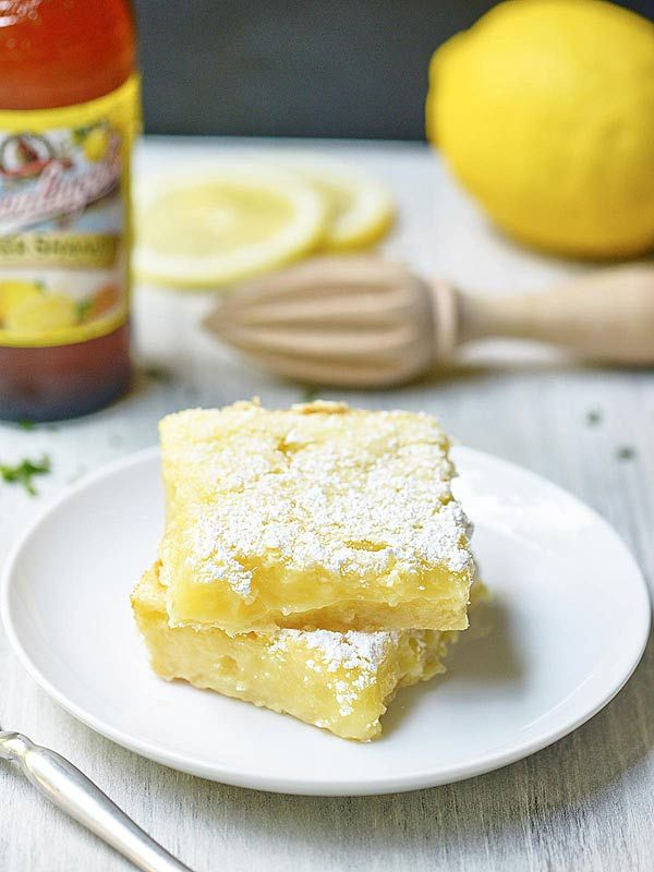 Summer Shandy Lemon Bars! The base: a shortbread crust. Rich, buttery, and sweet. The filling: a twist on a classic. Perfectly gooey, light and lemony!