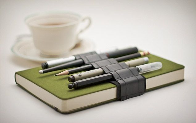 The simple joy of finding something to write with when you need it.  No more digging through the purse/briefcase/sofa/car for a !%#$ pen when you can stow a handful of pens within easy reach.  The Journal Bandolier is made of recycled rubber and available in custom sizes. http://www.etsy.com/listing/64357643/pencil-case-alternative-journal