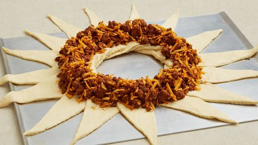 This taco-filled crescent ring is the perfect meal for Taco Night!  Dress it up with fresh shredded lettuce, chopped tomatoes and taco sauce for a fun twist on tacos!